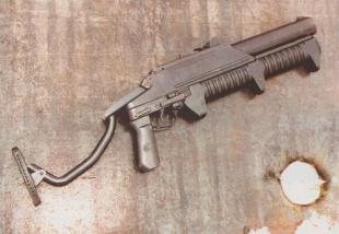 Результат стрельбы темробарическим выстрелом по деревянной двери, обитой стальным листом толщиной 2 мм.