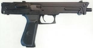 Пистолет-пулемёт ПП-93 со сложенным сверху прикладом. Такая конструкция позволяет легко скрыть его под одеждой.